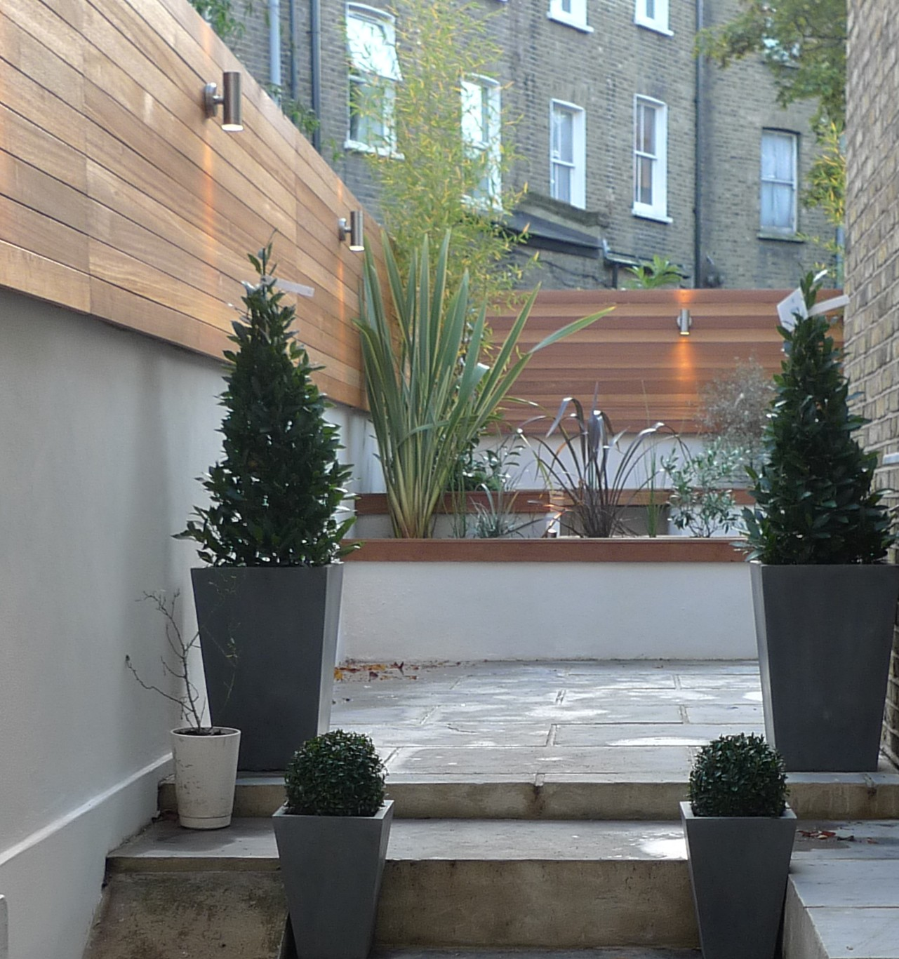 grey-sandstone-paving-with-hardwood-benches.JPG