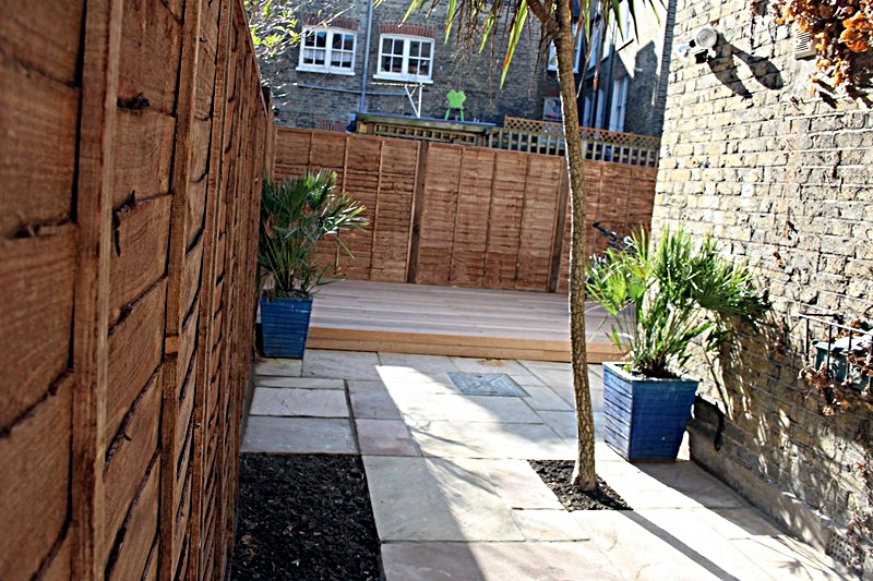 sandstone-paving-patio-installed-london-side-return-with-hardwood-decking.JPG