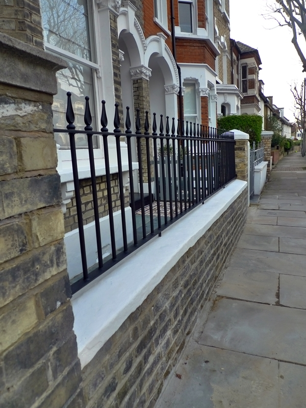 metal-rail-in-black-on-old-stock-brick-wall-burns-iron-and-metal-london-bespoke-metal-work.JPG
