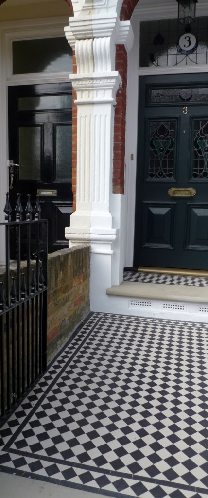 black and white victorian mosaic tile path with York stone london