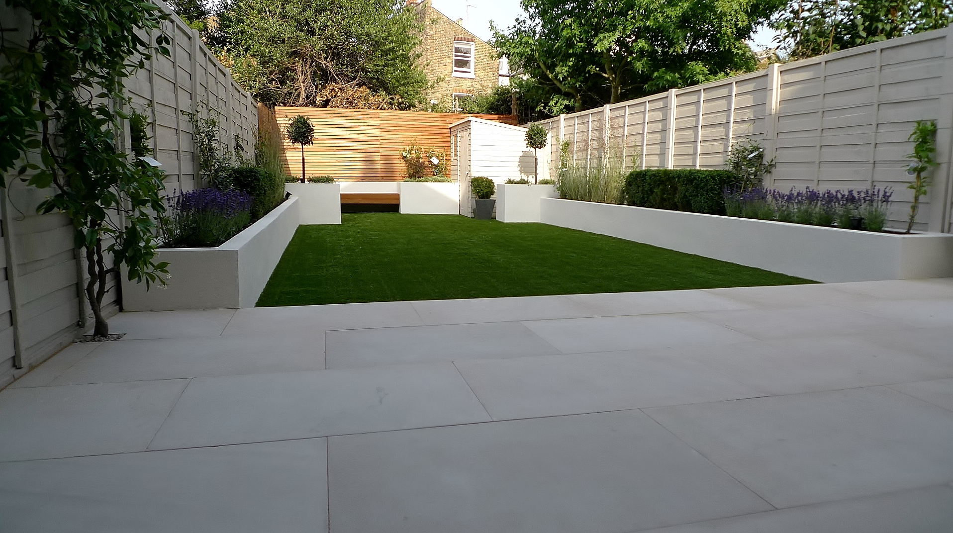 Sandstone london garden design for Modern low maintenance garden ideas