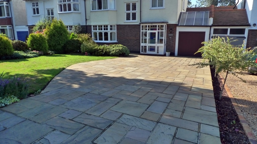 front garden driveway with mixed size sandstone paving london