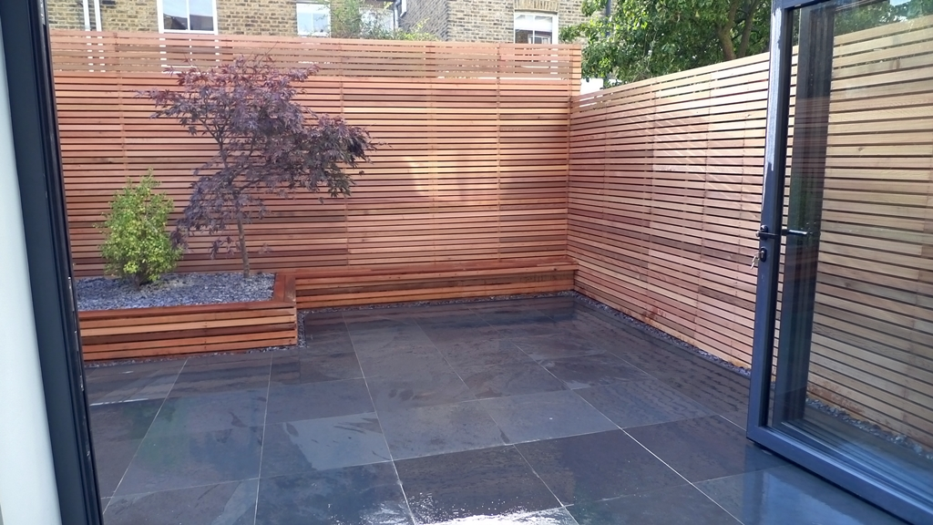 minimlaist garden slate paving raised beds cedar screens clapham garden design london