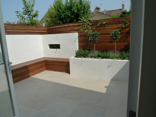 travertine paving hardwood privacy screen trellis fixed storage bench garden design london