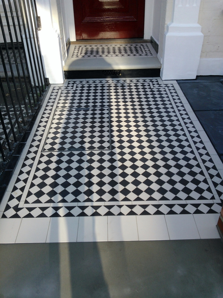 black and white victorian mosaic tile path with york stone south london