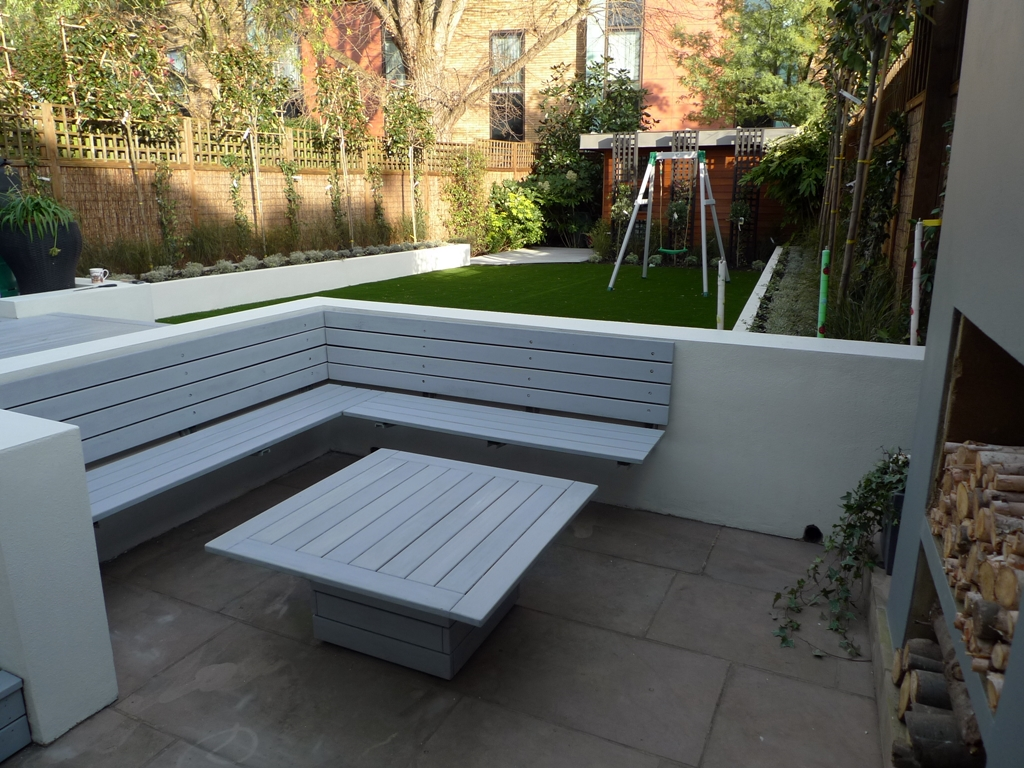 modern minimalist garden design low maintenance high impact garden design raised white wall beds grey decking east grass lawn turf sunken garden with fire and chimney flat trees balham wandsworth london (12)
