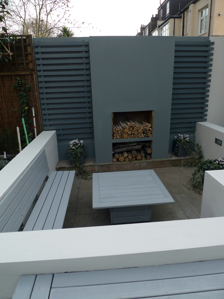 modern minimalist garden design low maintenance high impact garden design raised white wall beds grey decking east grass lawn turf sunken garden with fire and chimney flat trees balham wandsworth london (6)
