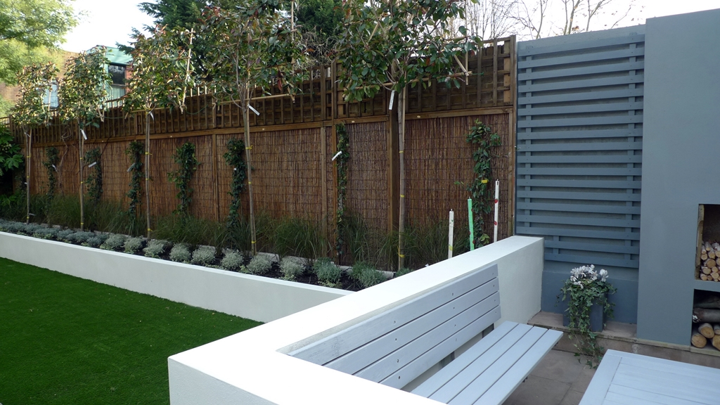 modern minimalist garden design low maintenance high impact garden design raised white wall beds grey decking