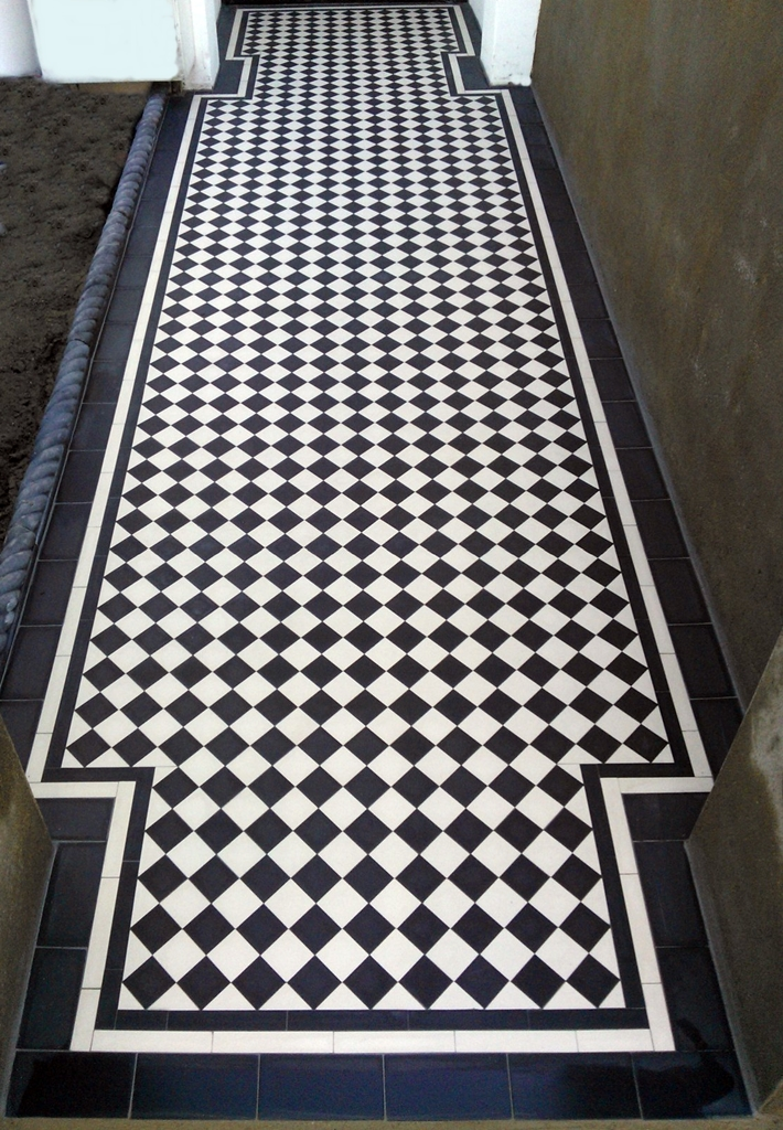 classic victorian and edwardian black and white chequer board mosaic tile garden path London