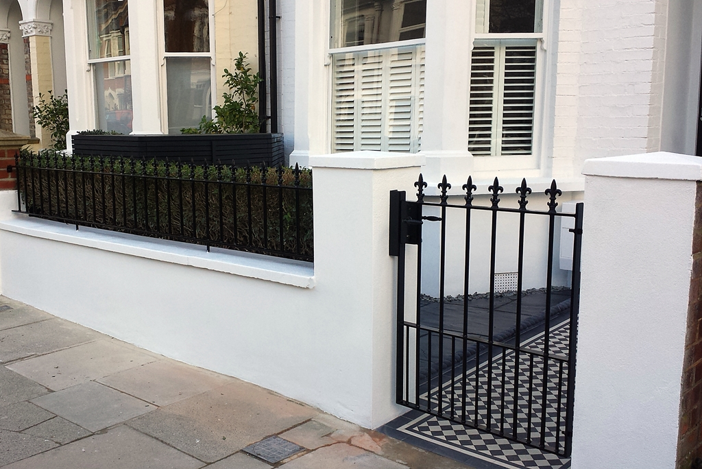 front garden wall metal rail and gate black and white mosaic path london