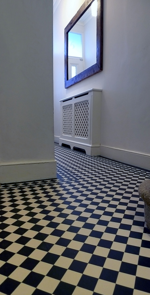 hallway black and white mosaic tile path with diamond border London