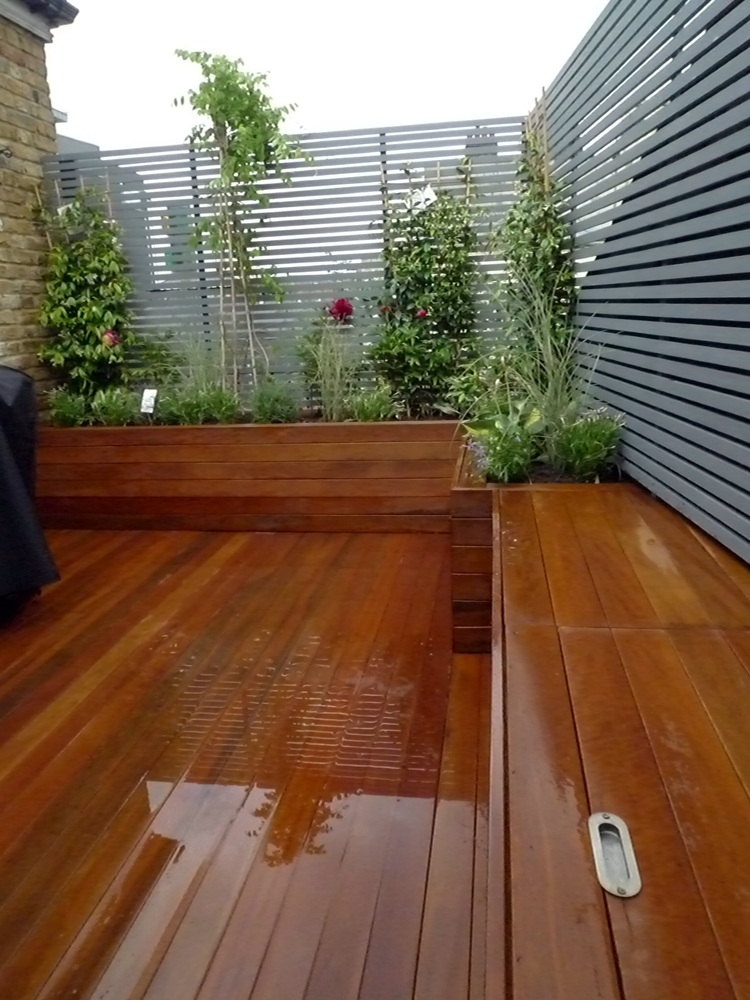 Wooden slatted horizontal privacy screen trellis in cedar for Deck trellis