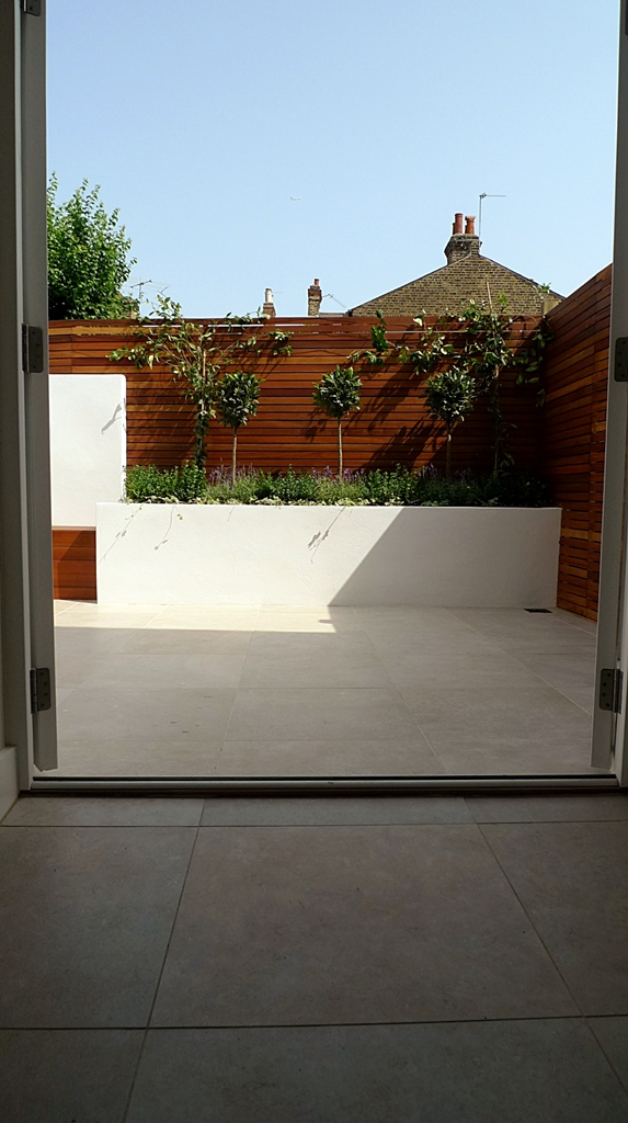hardwood privacy screen slatted fence in minimalist courtyard modern design london