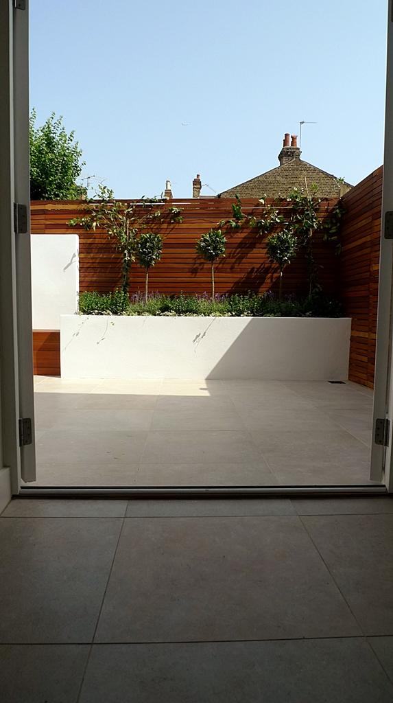 hardwood privacy screen slatted fence in minimalist courtyard modern design london
