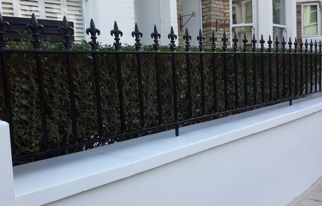 render front wall with wrought iron rail metal gate london