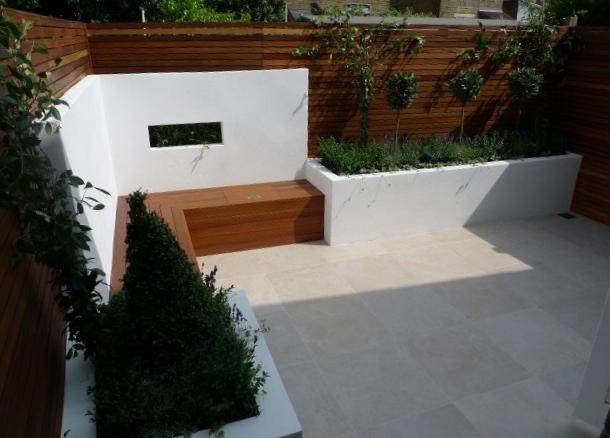 slatted hardwood privacy screen within modern garden design courtyard garden london