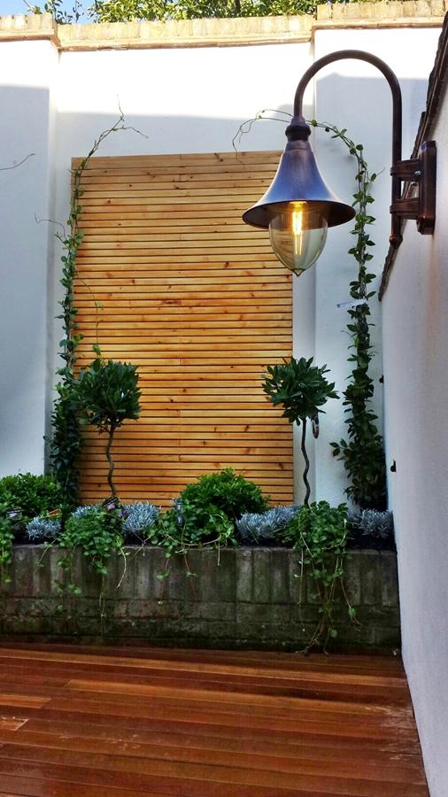 london decking courtyard garden formal topiary planting slatted screen hardwood balau decking