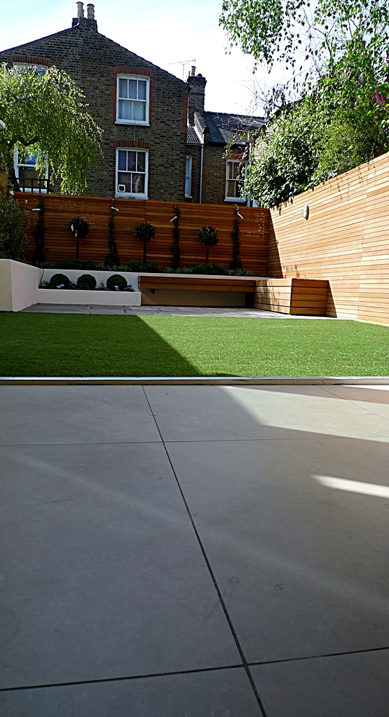 Hardwood Privacy Screen Trellis Slatted Batten Fence With Artificial Grass in Modern Low Maintenance Garden London