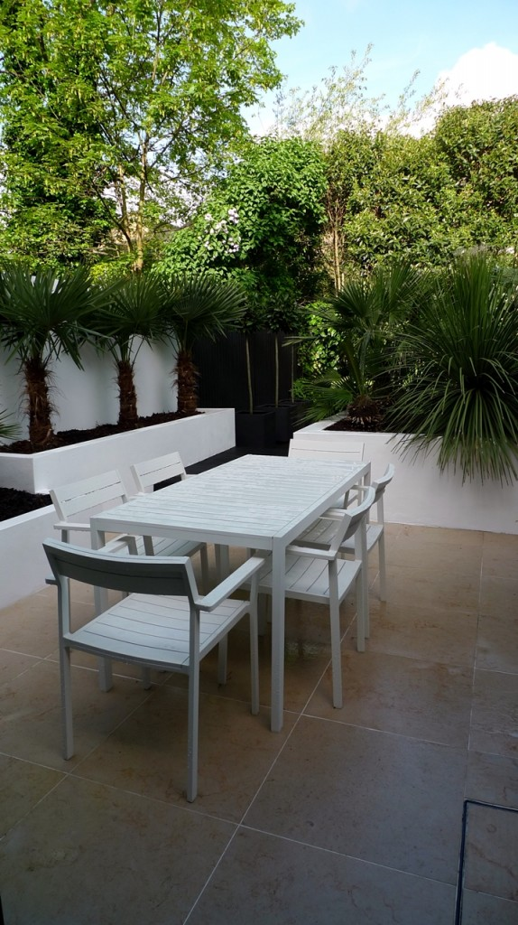 Modern Urban London Garden Design limestone paving white raised beds jet black decking and floating bench architectural planting