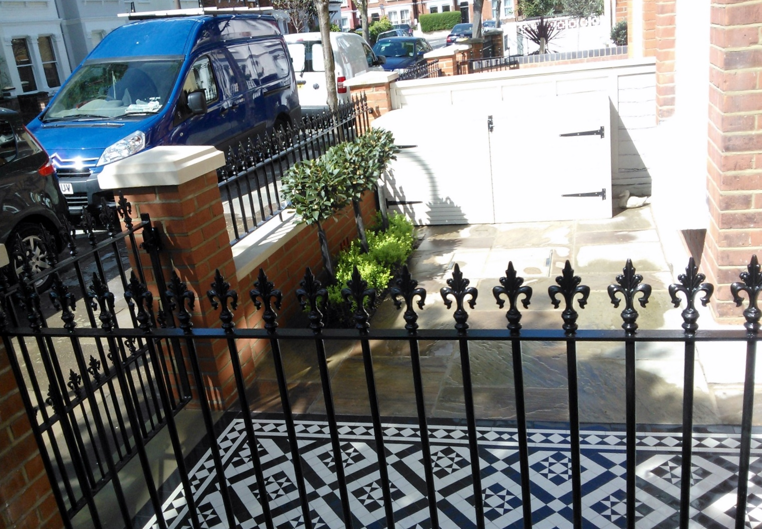 Black And White Victorian Mosaic Tile Path Red Brick Garden Wall Wrought Iron Rail And Gate