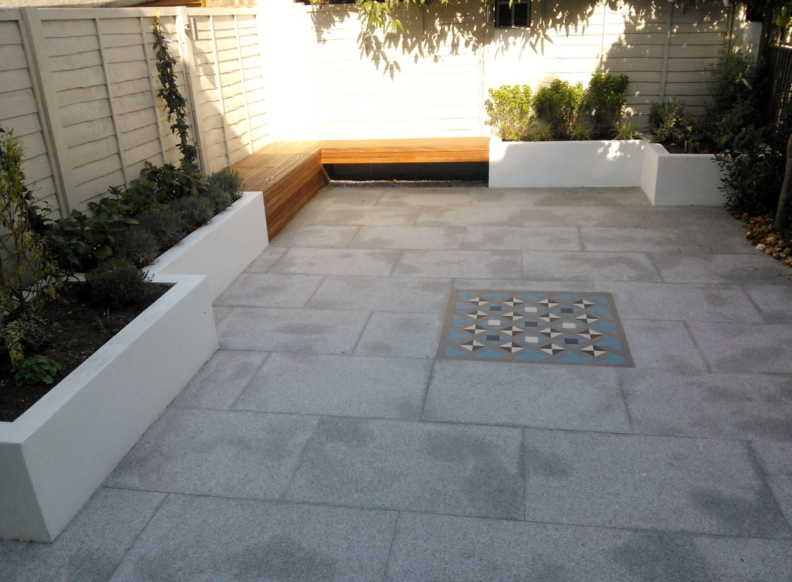 modern garden design london granite paving raised rendered beds