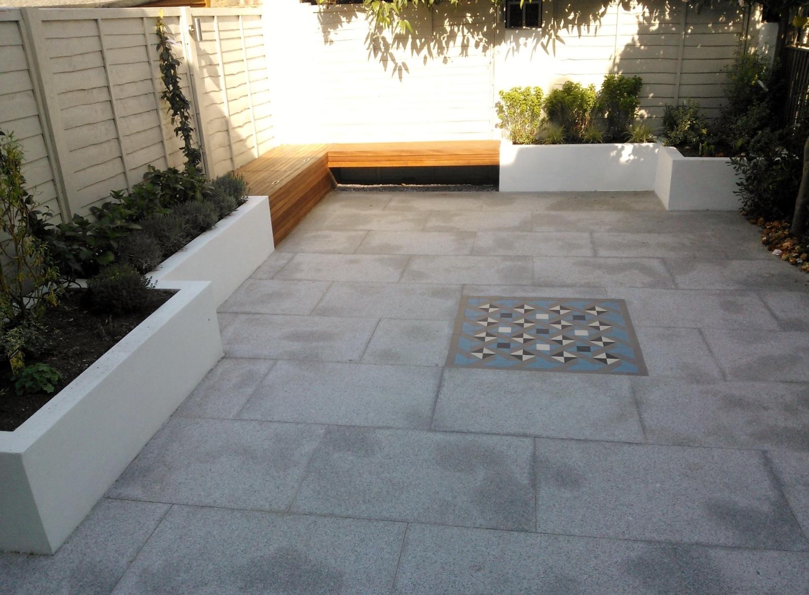 modern garden design london granite paving raised rendered beds