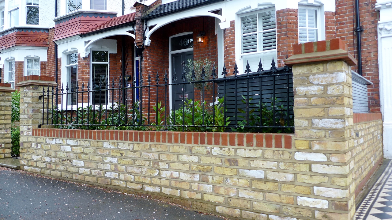 Bespoke front garden bike store paving slate patio front for Front garden brick wall designs
