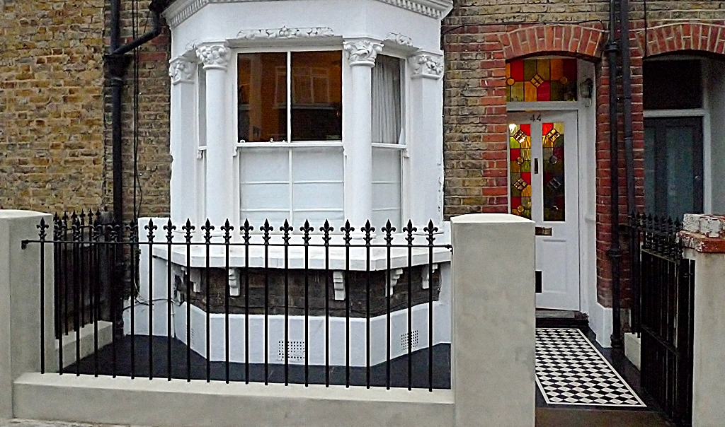 victorian front garden design london metal rail and gate paving and black and white mosaic tile