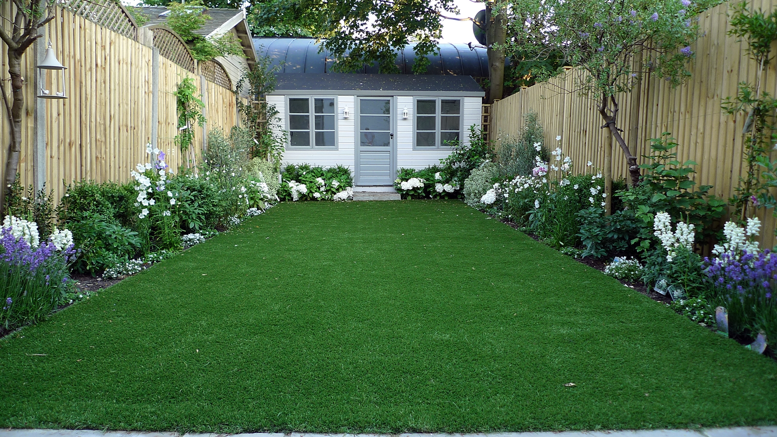 Artificial easy grass lawn summer house sandstone paving for Grasses planting scheme