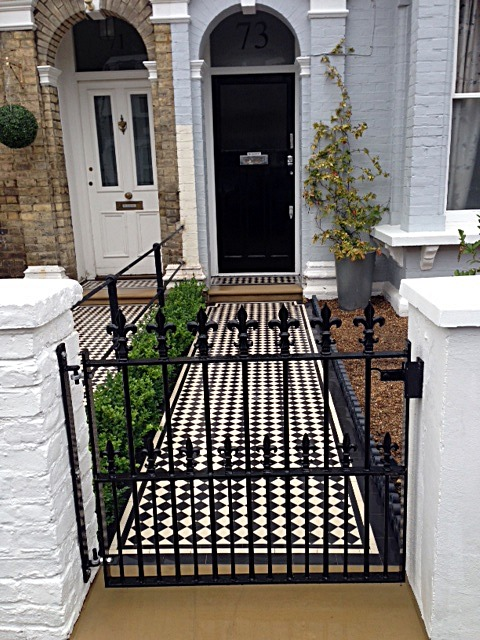 balham black and white victorian mosaic tile path sandstone paving yellow brick london wall and imperial metal wrought iron gate (1)