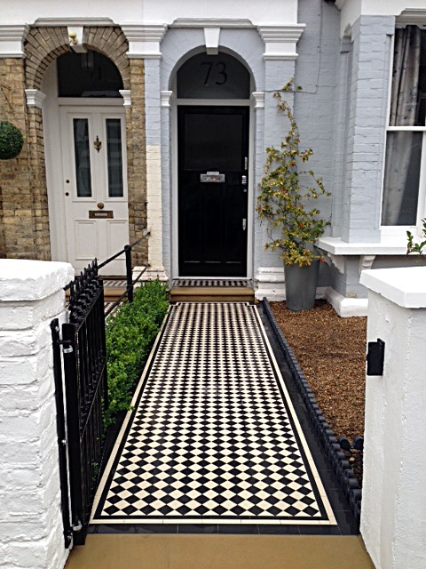 black and white victorian mosaic tile path york stone bull nose step victorian edge tile wrought iron metal work balham london