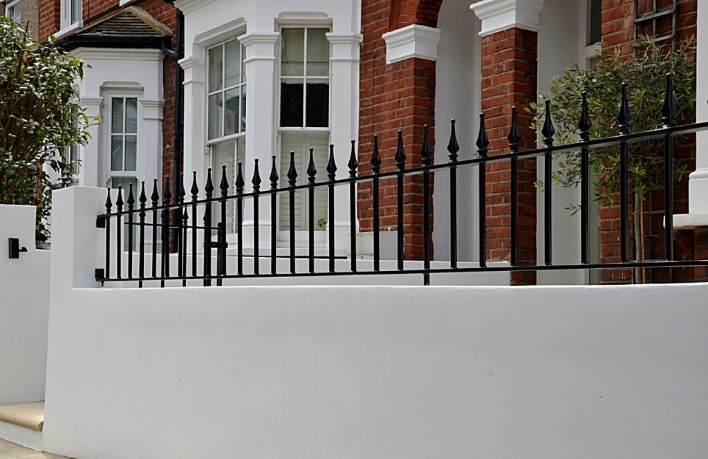 front garden wall painted white metal wrought iron rail and gate victorian mosaic tile path in black and white scottish pebbles York stone balham london (15)
