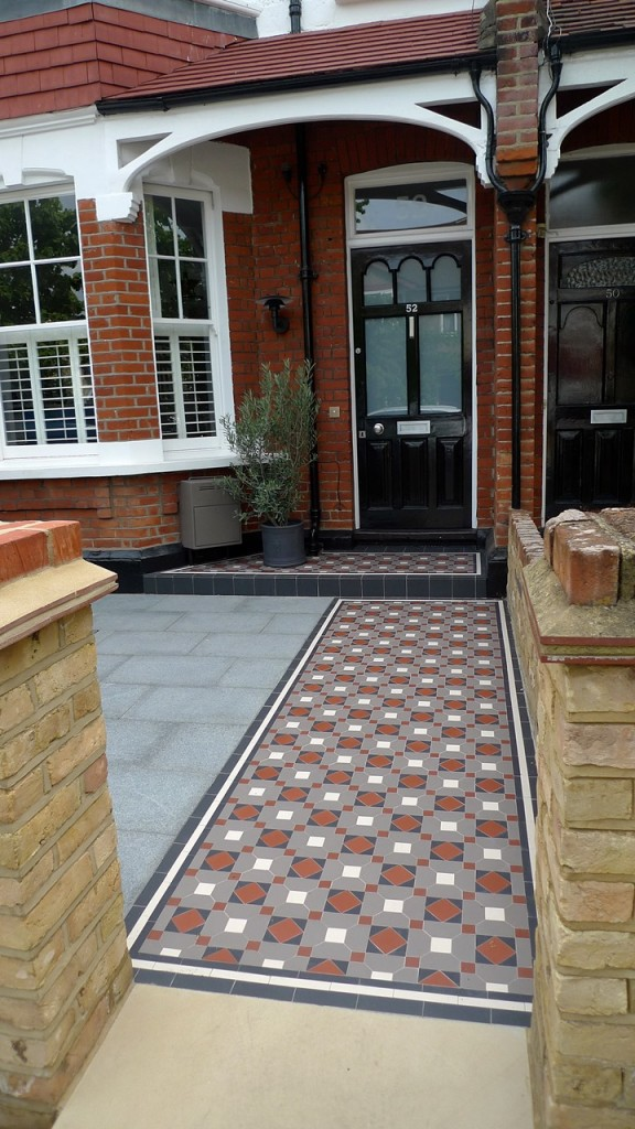 yellow london brick wall with red rubber trim and york stone entance stone with granite paving