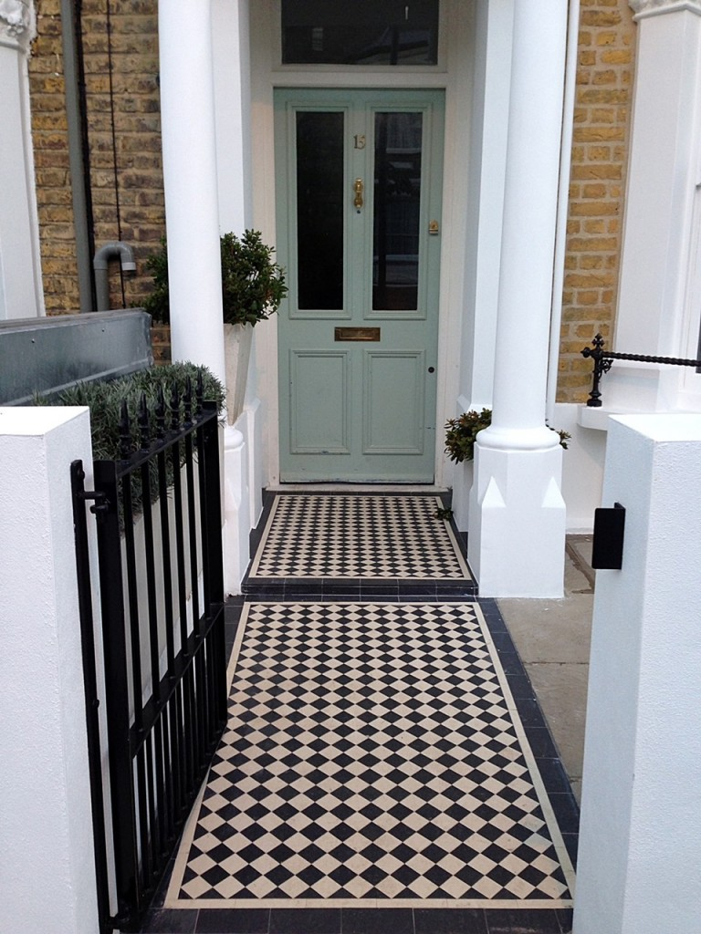 black and white victorian mosaic tile path rendered plastered white walls with wrought iron metal rails and gate peckham new cross london (3)