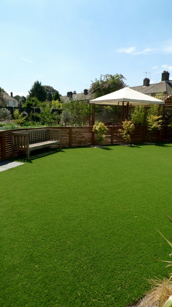 large modern garden design earlsfield south west london artificial grass hardwood screens balau decking slate paving patio mature planting (26)