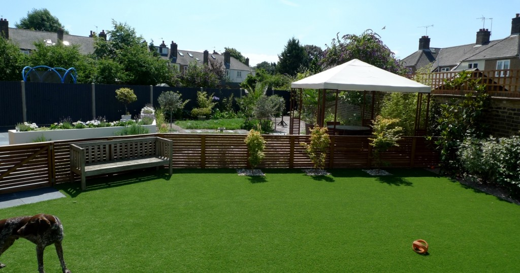 large modern garden design earlsfield south west london artificial grass hardwood screens balau decking slate paving patio mature planting (29)