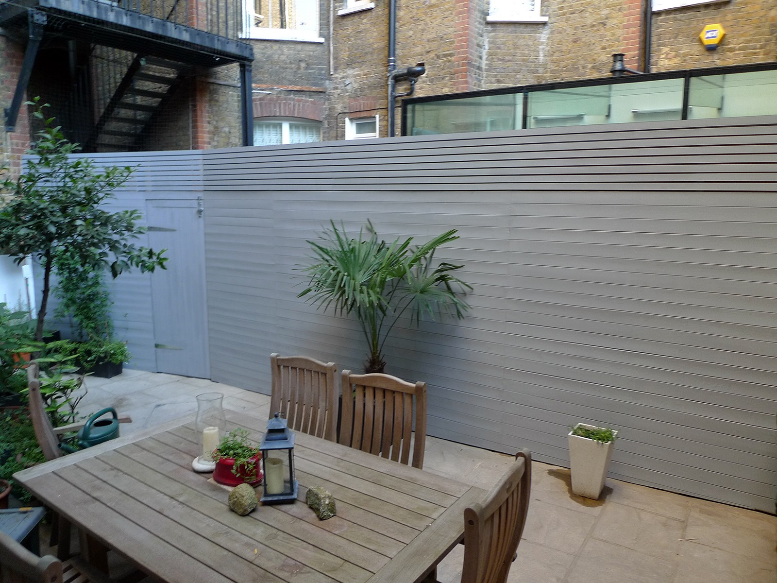 Grey closed board fence and privacy screen trellis Fulham ...