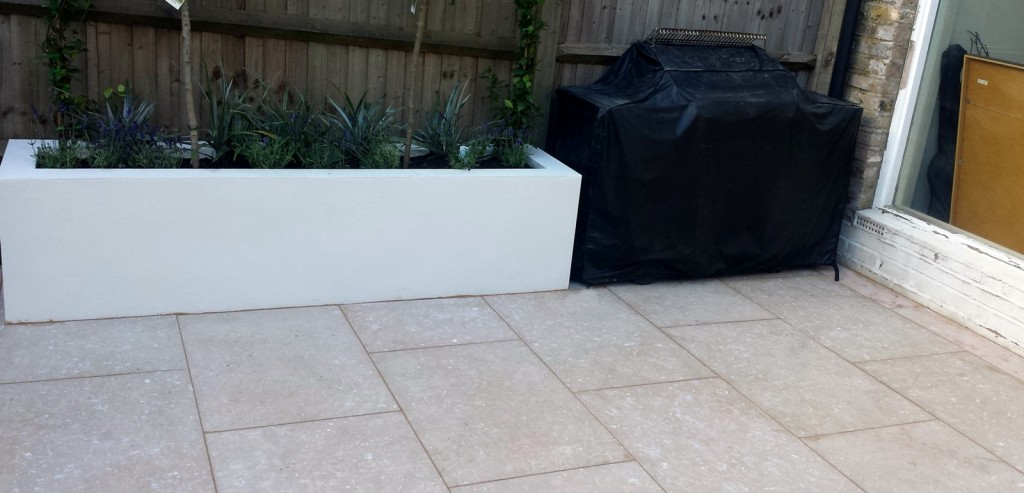 grey limestone patio paving raised beds floating hardwood bench clapham london (7)
