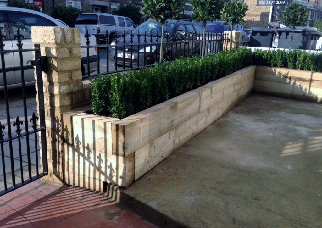 Yellow brick garden wall metal rail and gate bay and buxus topiary Clapham Battersea Balham London (10)