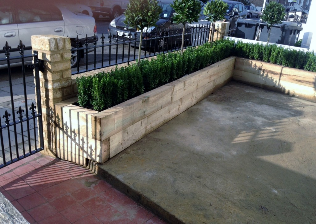 Yellow brick garden wall metal rail and gate bay and buxus topiary Clapham Battersea Balham London (11)