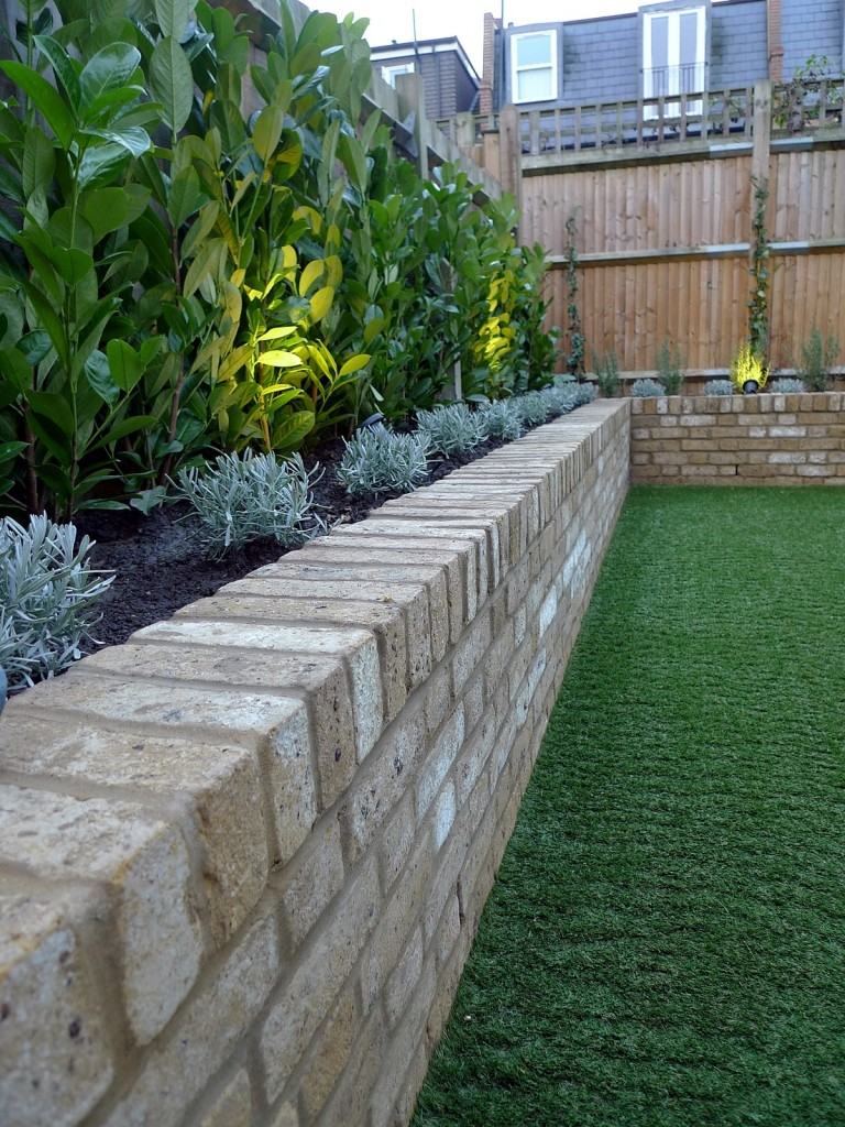 Yellow brick raised bed walls artificial fake easy grass lawn mixed planting herne hill dulwich london (12)