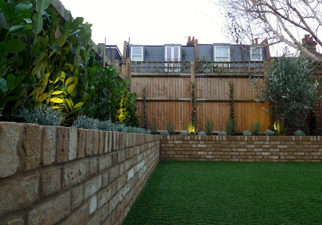 Yellow brick raised bed walls artificial fake easy grass lawn mixed planting herne hill dulwich london (16)