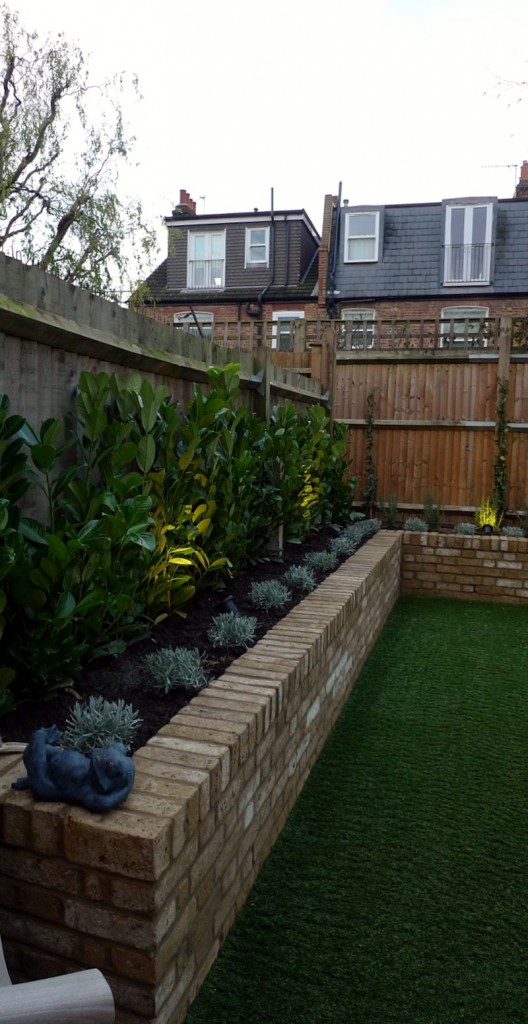 Yellow brick raised bed walls artificial fake easy grass lawn mixed planting herne hill dulwich london (2)