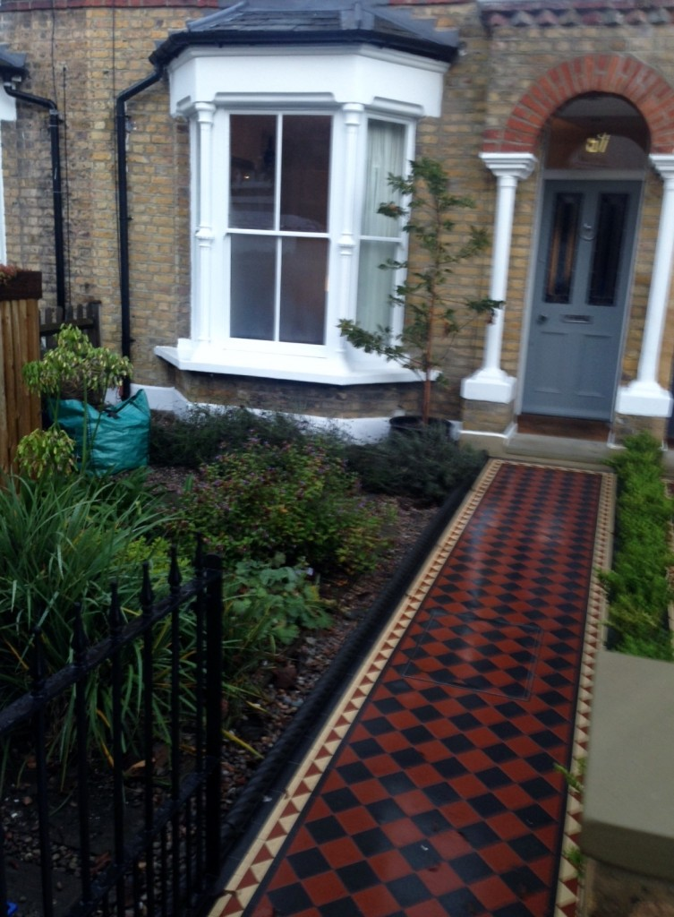 black and red victroian mosaic tile path london
