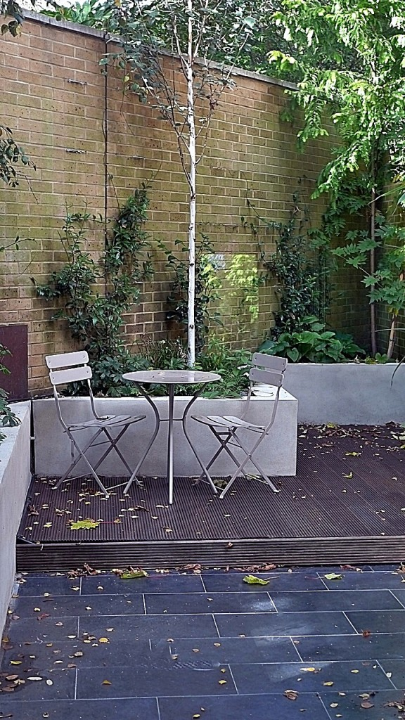 modern london walled garden with raised beds slate tiles and decking designer balham clapham battersea