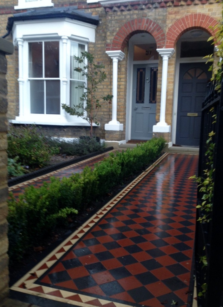 mosaic tile path herne hill london with wall and gate and buxus hedge