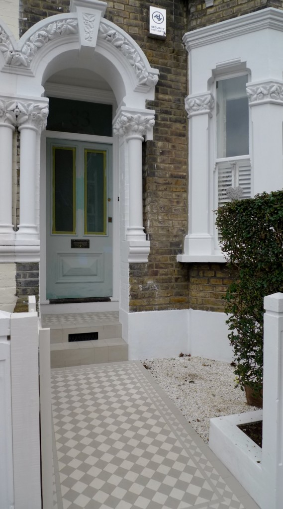 grey and white classic victorian mosaic tile path london
