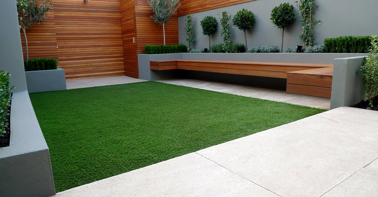 Modern and contemporary garden design battersea clapham for Modern house design with garden
