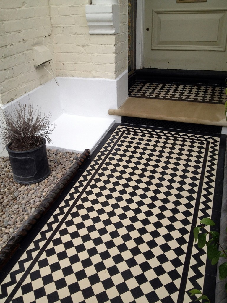 balham and tooting black and white victorian mosaic tile path York stone bullnose entrance and step white render block brick wall with rail metal gate london