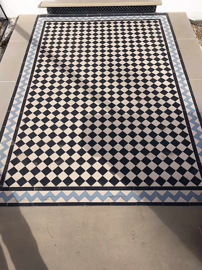 black and white and blue victorian mosaic tile path with zig zag border balham london